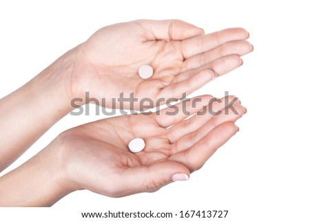 Choice of pill, closeup on white