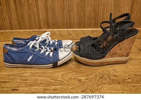 Choice of shoes - sneakers or sandals with high heels - stock photo