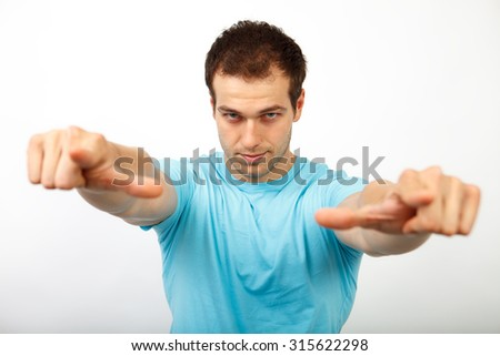 Choice or pick concept - cool young man pointing towards you - stock photo