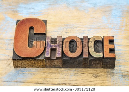choice word in vintage letterpress wood type blocks stained by color inks - stock photo