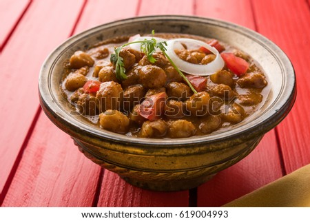 Chole or Chana Masala or Spicy Chickpeas is traditional North Indian main course recipe and usually served with Bhature or Roti/ Naan. Selective focus