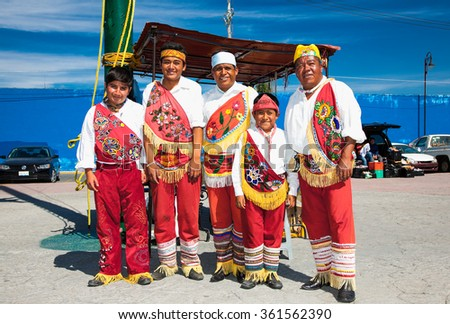 CHOLULA, MEXICO-DEC 5, 2015:Dance of Papantla's flyers in Cholula, Mexico on Dec 5, 2015. Mexican tradition of the ritual ceremony of the Voladores, known as the Voladores de Papantla - stock photo