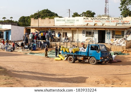 CHOMO - ZAMBIA - OCTOBER 14 2013: Local people go about day to day life in Chomo, Zambia, Africa - stock photo