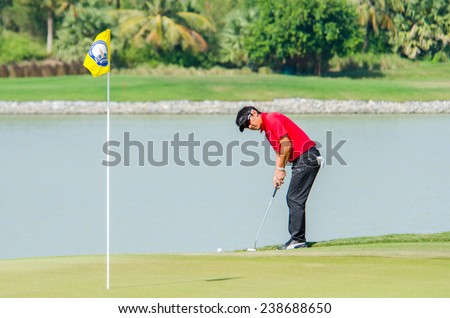 CHONBURI - DECEMBER 14 : Unho Park of Australia player in Thailand Golf Championship 2014 (Tournament on the Asian Tour) at Amata Spring Country Club on December 14, 2014 in Chonburi, Thailand. - stock photo