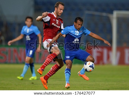 CHONBURI-FEB 9,2014: Adul Lahsoh (blue) player of Chonburi FC in action during football AFC Champions League 2014 between Chonburi FC and South China at Chonburi Stadium on February 9,2014 in Thailand