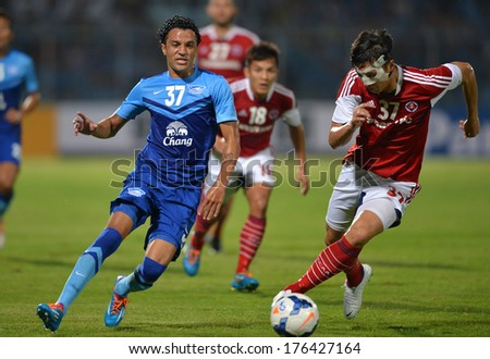 CHONBURI-FEB 9,2014: Thiago Cunha(blue) player of Chonburi FC in action during football AFC Champions League 2014 between Chonburi FC and South China at Chonburi Stadium on February 9,2014 in Thailand