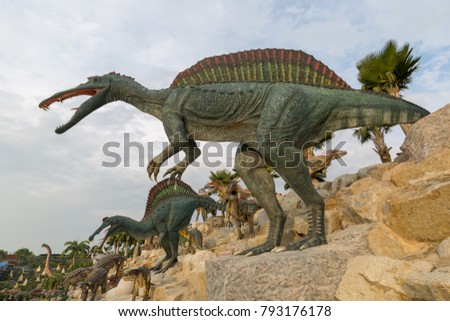 CHONBURI - JAN,14 : Dinosaur Valley have many Giant dinosaur figurines but stony slopes overgrown with palm trees Where is tropical park in Nong Nooch Tropical Botanical Garden.THAILAND JAN, 14 2018