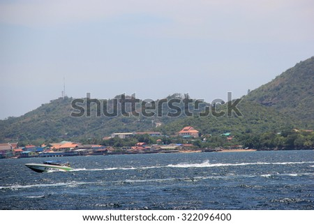 Chonburi, Thailand - April 26, 2014: Speedboat is driven in blue ocean of Thailand.