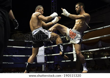 CHONBURI, THAILAND- APRIL 6 : Unidentified boxers compete in Thai Fight:Muay Thai World's Unrivaled Fight on  April 6, 2013 , in Chonburi ,  Thailand - stock photo