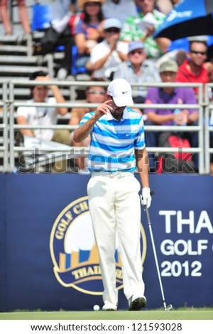 CHONBURI, THAILAND - DECEMBER 8 : Charl Schwartzel in action during The Golf Championship Thailand Round 3 at Ammata Spring Country Club on December 8, 2012 in Chonburi, Thailand. - stock photo