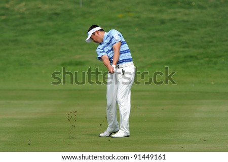 CHONBURI, THAILAND - DECEMBER 15:Daisuke MARUYAMA of Japan plays a shot during day one of the Thailand Golf Championship at Amata Spring Country Club on December 15, 2011 in Chonburi, Thailand.