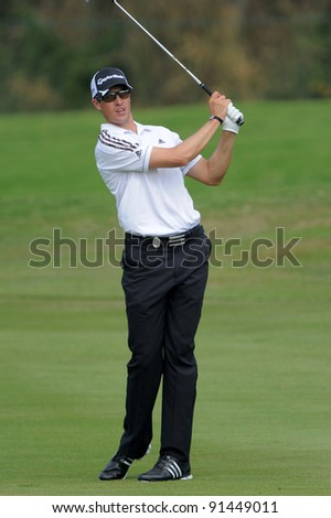 CHONBURI, THAILAND - DECEMBER 15:Darren BECK of Australia plays a shot during day one of the Thailand Golf Championship at Amata Spring Country Club on December 15, 2011 in Chonburi, Thailand.