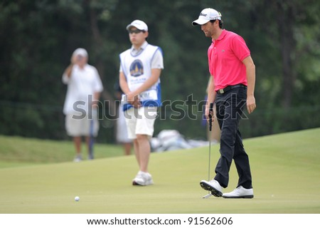 CHONBURI, THAILAND - DECEMBER 15:Gregory BOURDYof France plays a shot during day one of the Thailand Golf Championship at Amata Spring Country Club on December 15, 2011 in Chonburi, Thailand.