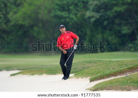 CHONBURI, THAILAND - DECEMBER 15: Jeev Milkha Singh of India plays a shot during day one of the Thailand Golf Championship at Amata Spring Country Club on December 15, 2011 in Chonburi, Thailand.