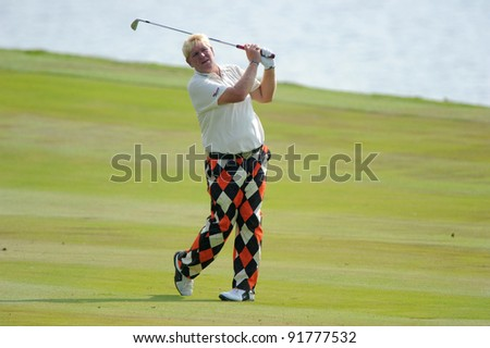 CHONBURI,THAILAND - DECEMBER 15:John Daly of United States plays a shot during day one of the Thailand Golf Championship at Amata Spring Country Club on December 15, 2011 in Chonburi, Thailand.