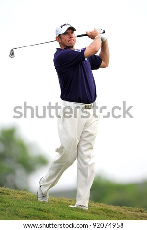 CHONBURI, THAILAND - DECEMBER 16: Lee Westwood of England in action during day two of the Thailand Golf Championship at Amata Spring Country Club on December 16, 2011 in Chonburi province, Thailand. - stock photo