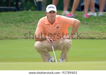 CHONBURI,THAILAND - DECEMBER 15: Michael Thompson of the United States plays a shot during day one of the Thailand Golf Championship at Amata Spring Country Club on December 15, 2011 in Chonburi, Thailand.