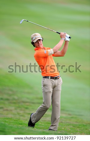 CHONBURI,THAILAND - DECEMBER 16:Ryo ISHIKAWA of Japan in action during day two of the Thailand Golf Championship at Amata Spring Country Club on December 16, 2011 in Chonburi province, Thailand.