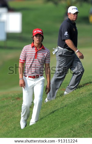 CHONBURI, THAILAND - DECEMBER 15:Ryo Ishikawa of Japan plays a shot during day one of the Thailand Golf Championship at Amata Spring Country Club on December 15, 2011 in Chonburi, Thailand.