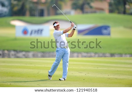CHONBURI,THAILAND-DECEMBER 6:Scott Barr of Australia plays a shot during hole 2 day one of the Thailand Golf Championship at Amata Spring Country Club on December 6, 2012 in Chonburi,Thailand.