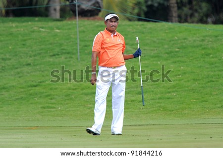 CHONBURI,THAILAND - DECEMBER 15: Thaworn WIRATCHANT ofThailand plays a shot during day one of the Thailand Golf Championship at Amata Spring Country Club on December 15, 2011 in Chonburi, Thailand.