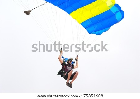 CHONBURI, THAILAND - FEB 07: Unidentified parachutist in the sky on Feb 07, 2014 in Chonburi, Thailand.