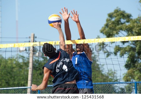 CHONBURI, THAILAND-JAN 18 : Dunvinit  of Institute of Physical education in block during Beach Volleyball 40th. Thailand University Games at Chonburi stadium on Jan 18, 2013 in Chonburi, Thailand . - stock photo