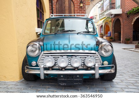 Chonburi , Thailand - JAN 17, 2016 : Green mini cooper in swiss sheep farm  - stock photo