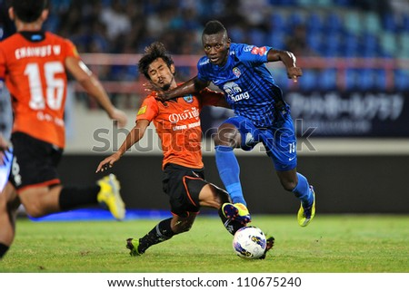 CHONBURI,THAILAND-14 JULY:Fode Bangaly Diakite (blue) of Chonburi fc. in action during Thai Premier League between Chonburi fc.and Samut Songkhram fc.at Chonburi Stadium on July 14,2012 in Thailand