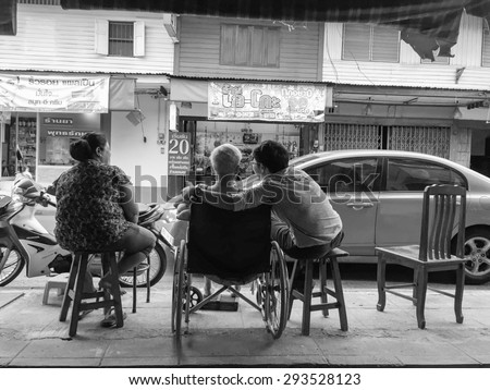 CHONBURI, THAILAND - JULY 5, 2015: Local Thai People Living at Chonburi, Thailand on Jul 5, 2015. Grown up child normally take care parent till death though they married. Black&White Photoshop Filter.