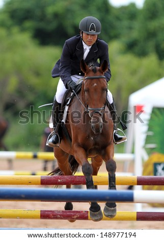 CHONBURI, THAILAND - JULY 28:Negishi Atsushi of Japan with Rata 21 in action during 1st FEI Asian Eventing Championships 2013 at Thai Polo&Equestrian Club on July 28, 2013 in Chonburi, Thailand. - stock photo