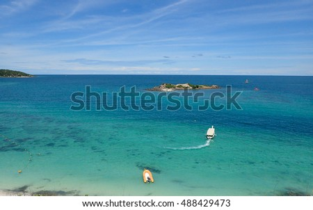CHONBURI, THAILAND, JULY 28, 2016: Snorkeling tourist moves to the island, White sand beach and clear seawater in Thailand