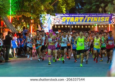 CHONBURI, THAILAND - 20 JULY 2014 - Unidentified fancy athletes start running in twelfth Walk and Run Phanat Nikhom Supper Mini-marathon race at Phanat Nikhom district, Chonburi, Thailand. - stock photo