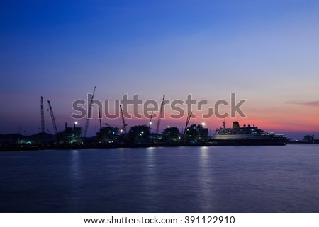 CHONBURI,THAILAND - MARCH 15,2016 : The merchant ship dock yard and port in gulf sea in twilight time.