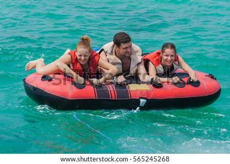 Chonburi, Thailand - March 16, 2015 :: Young people on water attractions during summer vacations
