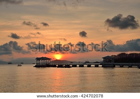 Chonburi,Thailand - May 6, 2016: Sunrise the time in the morning Asdang pier in Koh Sichang, Chonburi, Thailand.