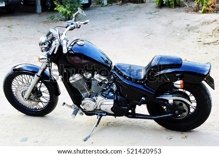 CHONBURI, THAILAND - NOVEMBER 24 2016 : Black motorcycle brand Honda Steed 400CC at the home Chonburi in Thailand.