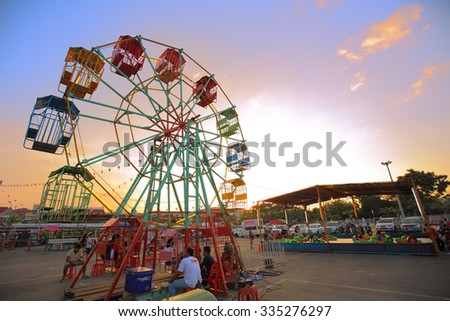 CHONBURI, THAILAND - NOVENBER 2015 :  Fun Park in Buffalo racing festival 2015 Twilight, multicolour from filter and lighting. An unidentified people in picture. 1 November 2015, Chonburi, Thailand.