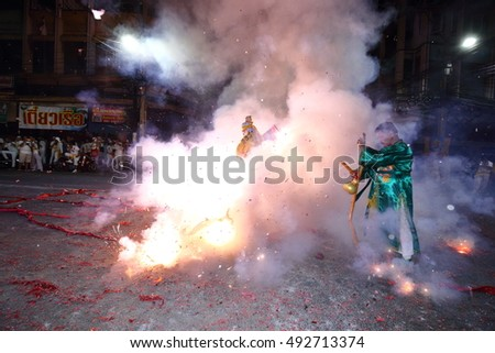 CHONBURI, THAILAND - 2016, October 2 : At night, The parade possessed by his god in Vegetarian Festival also known as Nine Emperor Gods Festival. Stop action and motion blur.