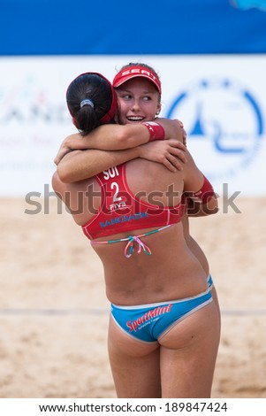CHONBURI, THAILAND-OCTOBER 26: Nina Betschart (R) of Switzerland celebrates a point with partner during Day 2 of Bangsaen Thailand Open on October 26, 2012 at Bangsaen Beach in Chonburi, Thailand - stock photo