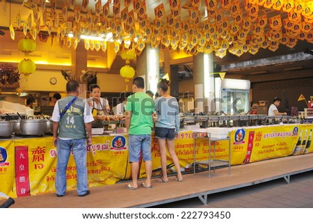 Chonburi, Thailand - Sep 30, 2014 - A restaurant with yellow flags sells vegetarian food during vegetarian food festival as following the traditional Chinese calendar.  - stock photo