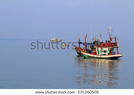 ChonBuri THAILAND-SEPTEMBER 23: A small fishing boat parked quietly in the morning of October 23, 2015 the beachfront of the Sattahip, Chonburi Thailand.