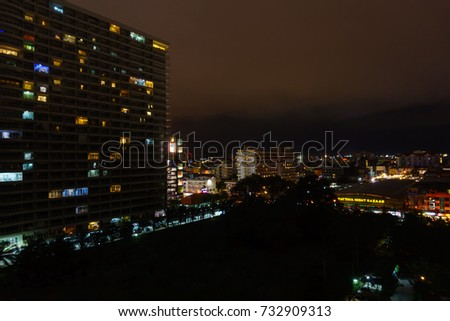 Chonburi,Thailand. September 29,2017. beautiful panorama landscape view of pattaya city at night after rain. cityscape at night with dark sky and cloud. business downtown city at night.