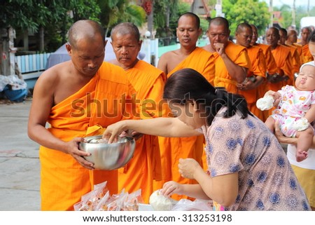 Chonburi, THAILAND - September 05 2015: Buddhist give food offerings to a Buddhist monk in morning