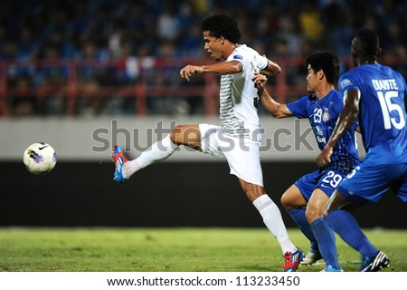 CHONBURI,THAILAND-SEPTEMBER18:Geilson De.Soares(white)of Al Shorta(SYR)for the ball during the AFC CUP quarter finals between Chonburi fc.and Al Shorta(SYR)at Chonburi Stadium on Sep18,2012inThailand - stock photo