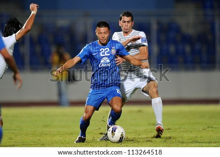 CHONBURI,THAILAND-SEPTEMBER18:Kazuto Kushida (blue)of Chonburi fc in action during the AFC CUP quarter finals between Chonburi fc.and Al Shorta(SYR) at Chonburi Stadium on Sep18,2012 in Thailand - stock photo