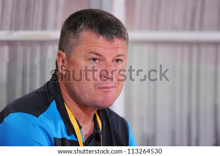CHONBURI,THAILAND-SEPTEMBER18:Manager Valeriu Tita of Al Shorta(SYR) in action during the AFC CUP quarter finals between Chonburi fc.and Al Shorta(SYR)at Chonburi Stadium on Sep18,2012inThailand - stock photo