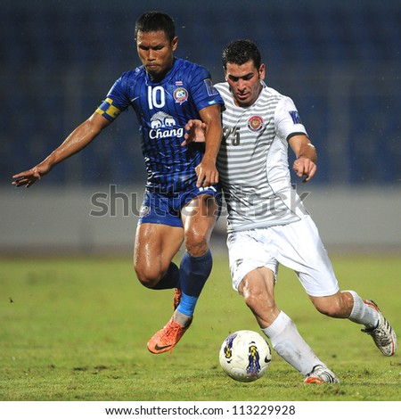 CHONBURI,THAILAND-SEPTEMBER18:Zaher Midani(white)of Al Shorta (SYR)for the ball during the AFC CUP quarter finals between Chonburi fc.and Al Shorta (SYR) at Chonburi Stadium on Sep18,2012 in Thailand - stock photo