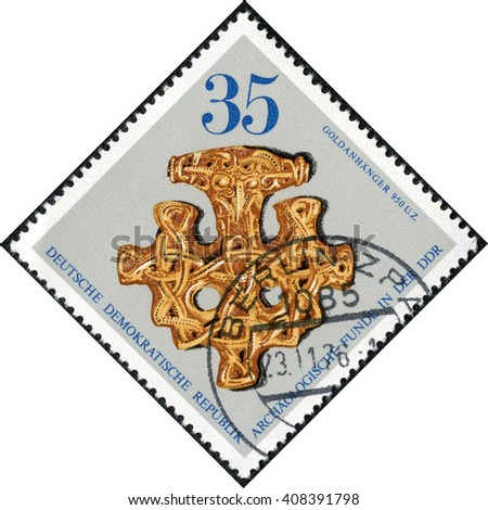 CHONGQING, CHINA - April 20, 2014:A stamp printed in German Democratic Republic shows a golden hanger, series, circa 1970s - stock photo
