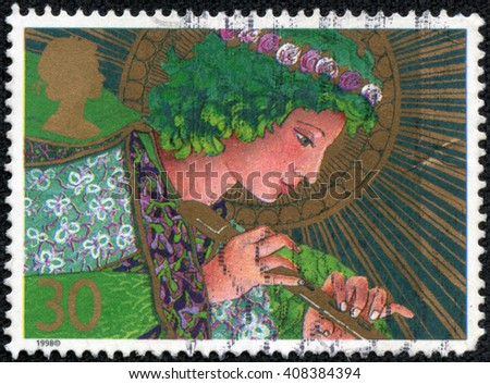 CHONGQING, CHINA - April 20, 2014:A stamp printed in Great Britain shows an angel, circa 1998 - stock photo